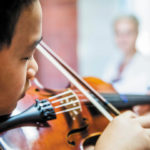 Luther College student plays the violin