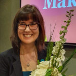 A former Luther College student receives an award at the Change Makers Conference