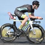Alum Ryan Walkenhorst riding a bicycle as part of World Ironman Championship