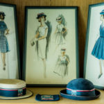 A close up of images and hats depicting Luther College uniforms of yesteryear