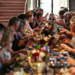 Luther College alumni dine at a lengthy banquet table